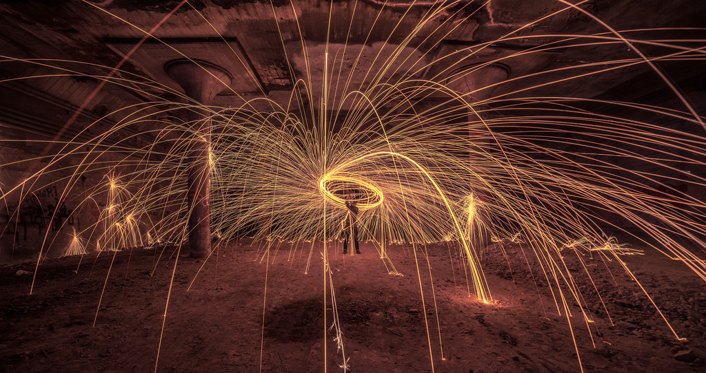 Tristan O'Tierney creates a fiery version of spin art in the Rochester Subway. [PHOTO: Tristan O'Tierney, Flickr]